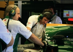 Inside the Lotus Team Garage at the Valencia Formula One Grand Prix - Engineers concentrate