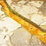 Ankle deep river of iron among flag stones in Spain