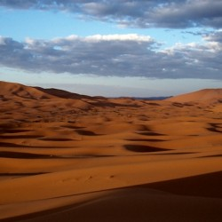 Shadows over sand dunes in the Sahara, Morocco