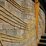 Yellow cables as tree roots in Girona's Flower Festival