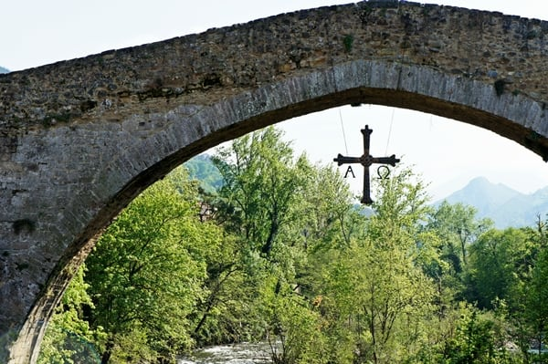 Asturian Cross hanging beneath bridge