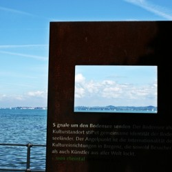 Travel Photo Quiz - Bronze Frame Over Water