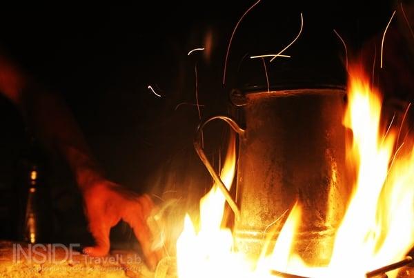Traditional Jordanian kettle on open fire while making Arabic coffee in Jordan