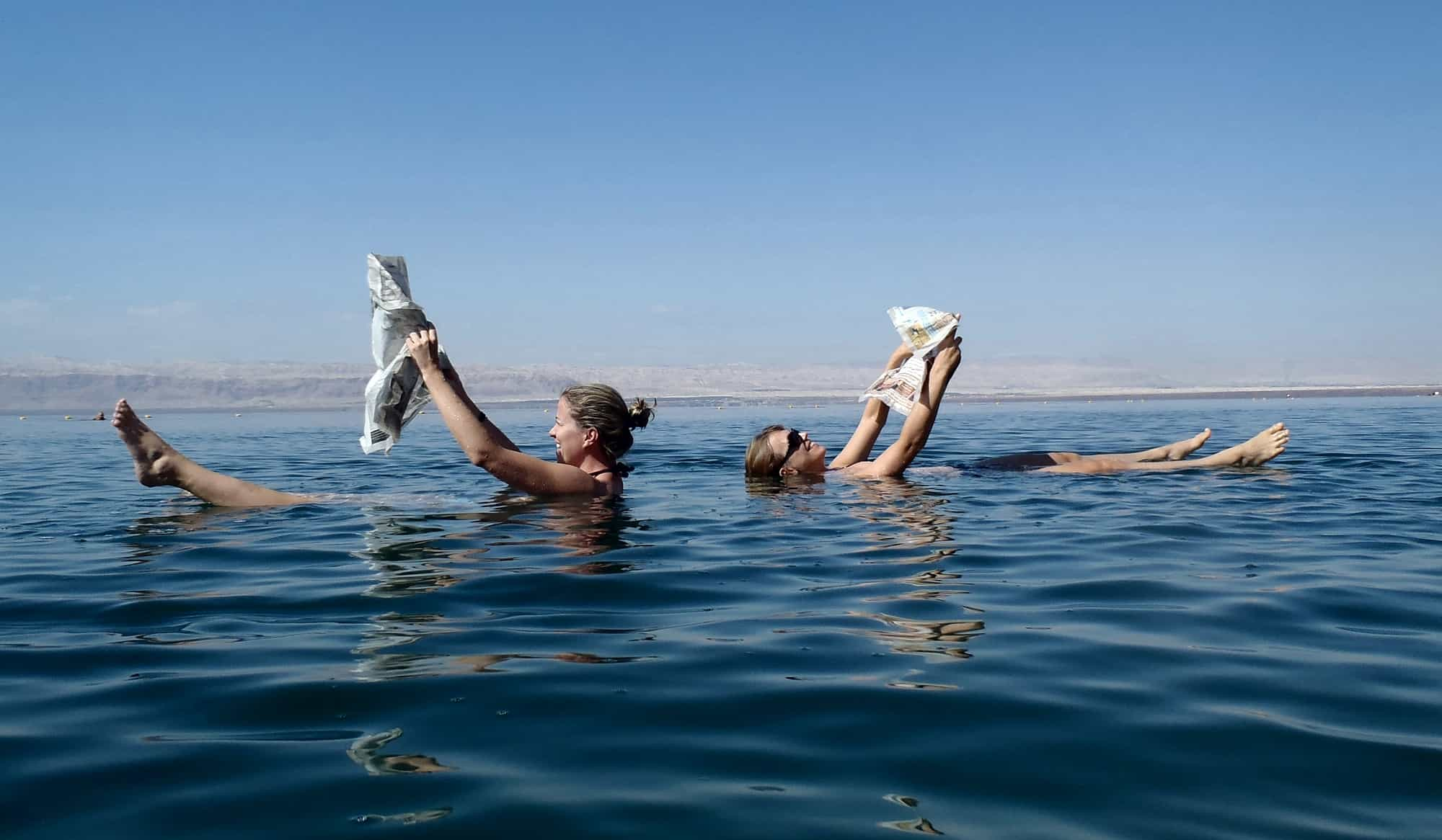 Reading newspapers while floating in the Dead Sea