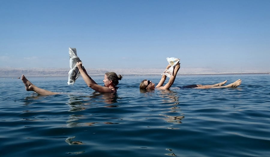 Reading newspapers in the dead sea in Jordan - an amazing thing to do in Jordan