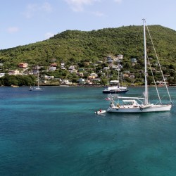 bequia with white boat
