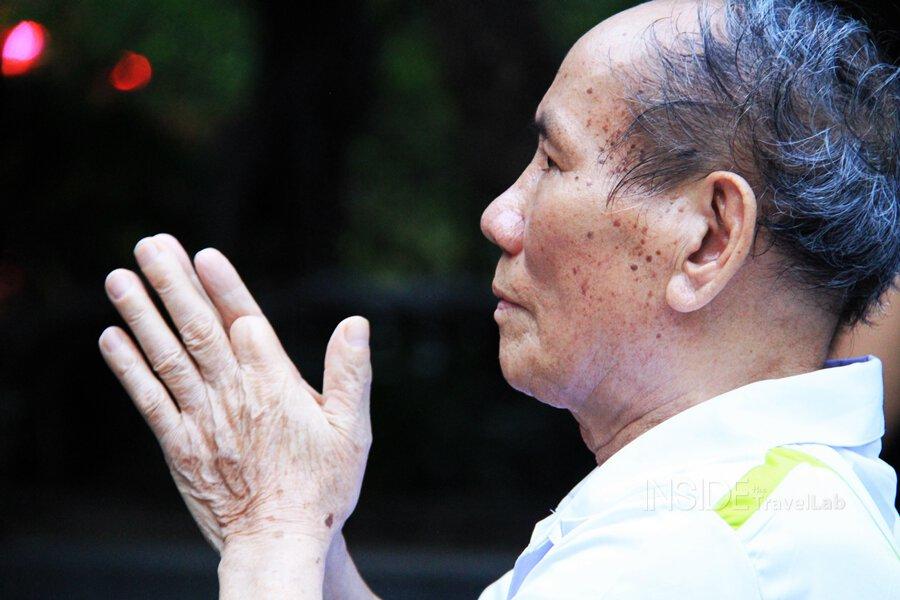 A man prays at Hoan Kiem lake in Hanoi Vietnam