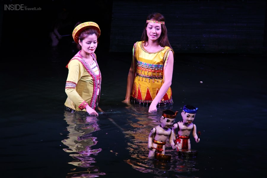Women showing water puppets in Hanoi Vietnam Itinerary Guide