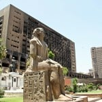 Burnt out NDP Building Cairo with ancient Egyptian statue