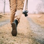 Best Travel Blogs - walking with camera