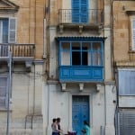 Blue balconies and people in Victoria Gozo