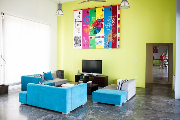 Sofas against a lime green wall in an artist studio