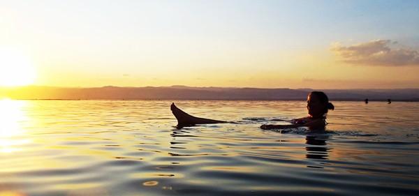 Jordan - Dead Sea - Sunset - Woman floating in water