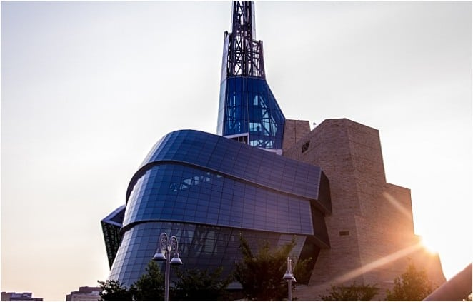 "The 100 metre Tower of Hope at The Canadian Museum for Human Rights takes place on the seventh floor, after 4000 square metres of galleries and exhibits. Exhibit planner Ralph Appelbaum described the experience as a ""journey from darkness to light"" and a ""climb to the mountain top."""