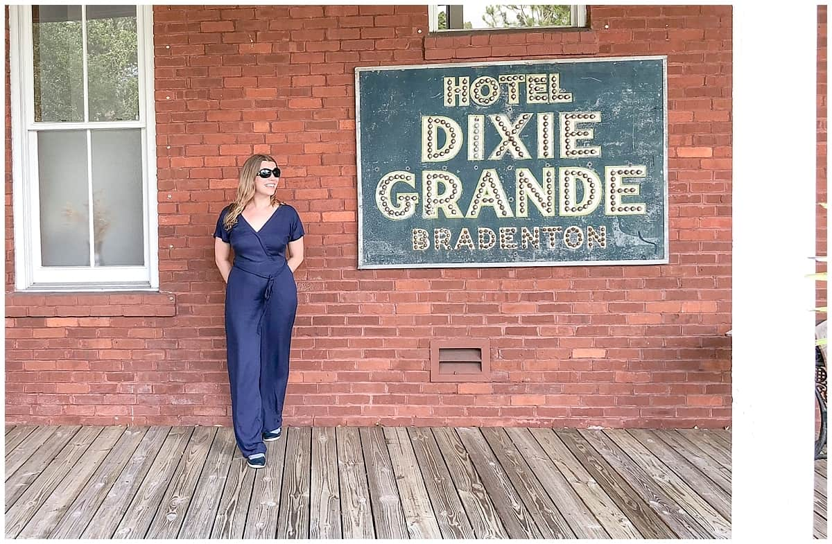 Abigail King stands outside Dixie Grande sign in Bradenton, Florida Gulf Coast