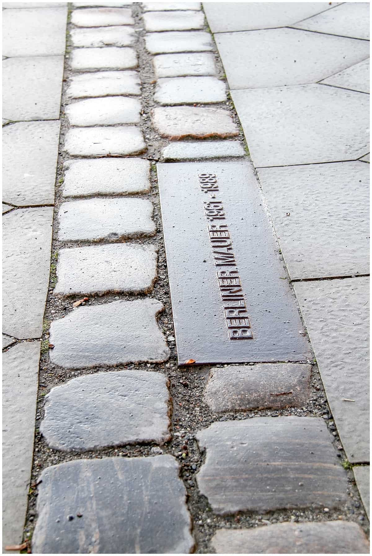 Germany - Berlin - Fragments of Berlin wall and plaque on street level
