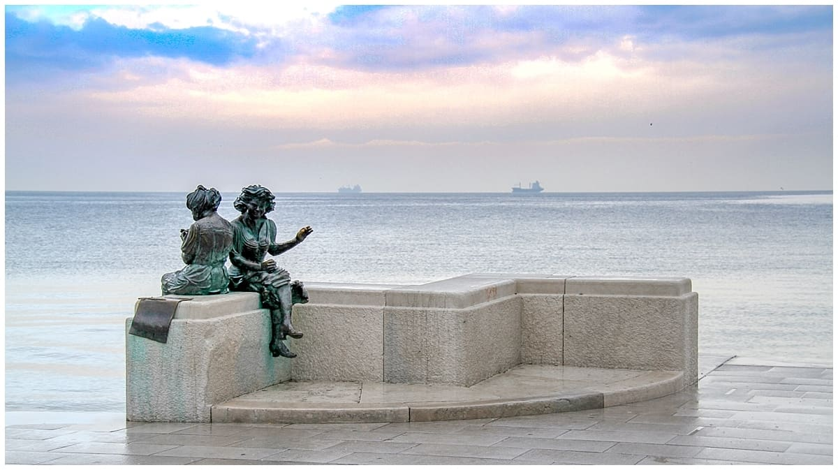 Trieste statue at the sea view onto the Adriatic