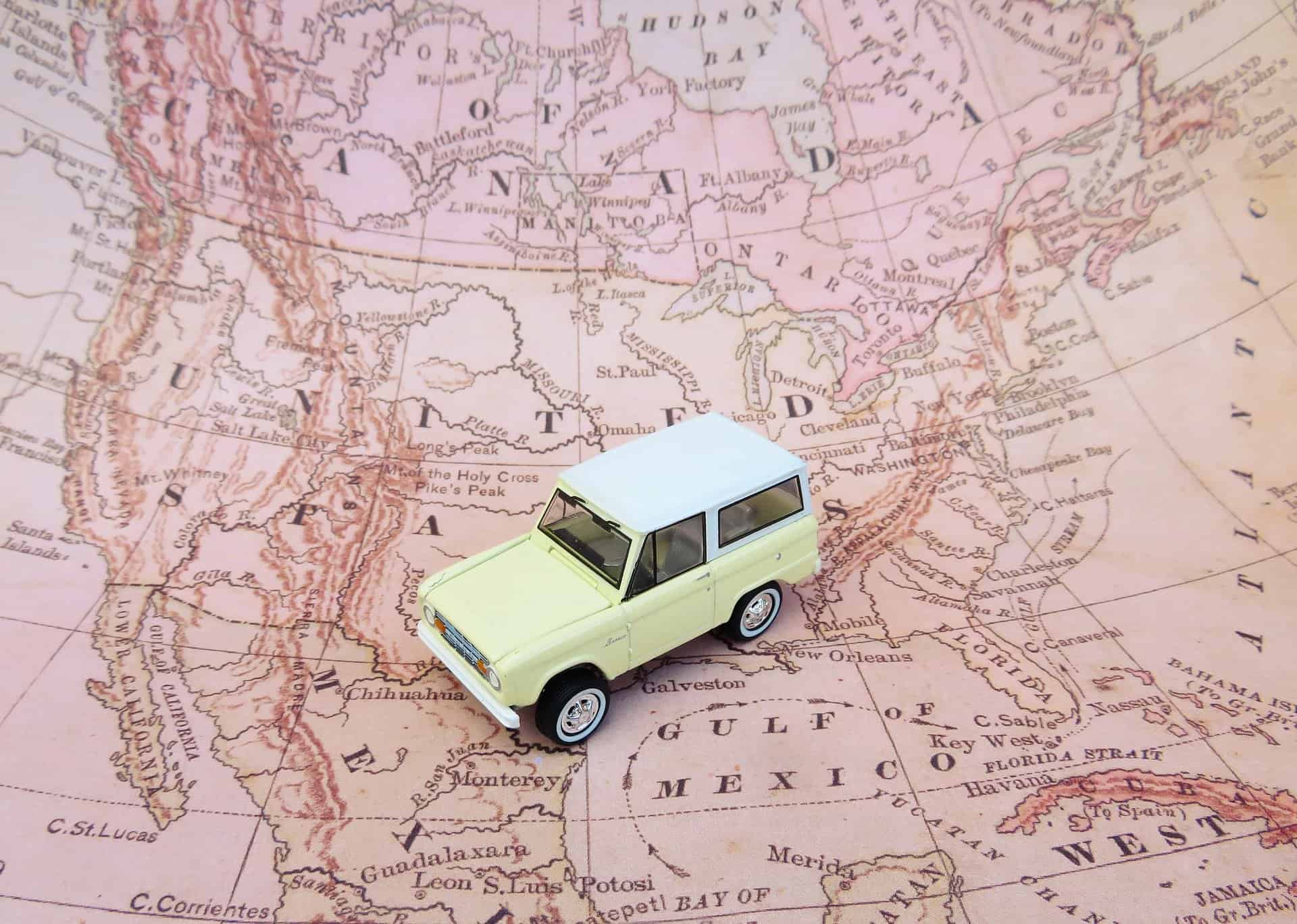 Road Trip Essentials - what to bring on a road trip - toy car on map of USA