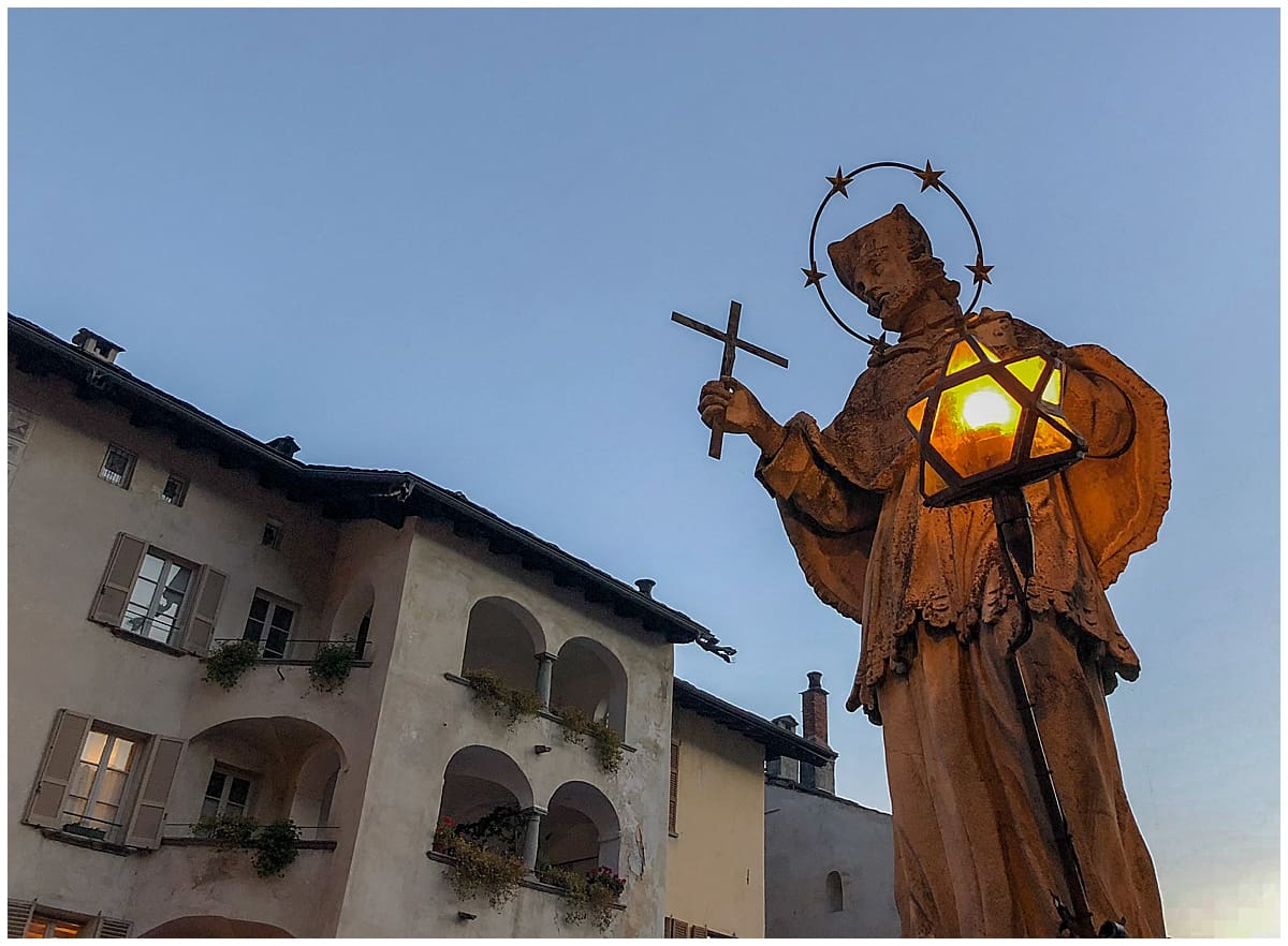 Statue on bridge in Chiavenna - an unusual thing to do in Italy