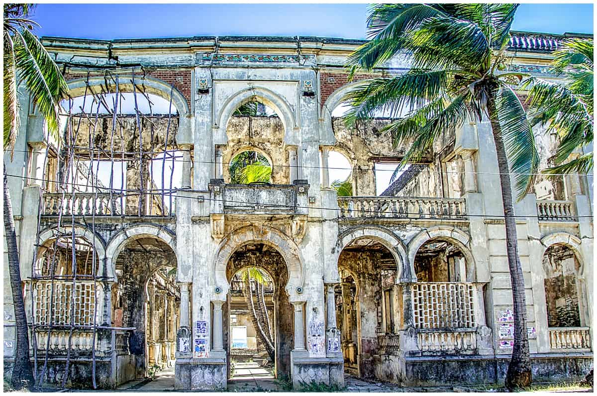 Faded colonial building with palm trees in Antsiranana Madagascar
