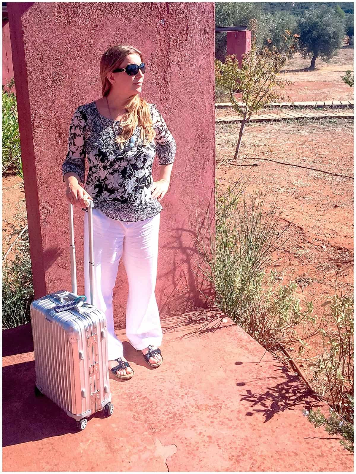 Abigail King with Carry On Suitcase