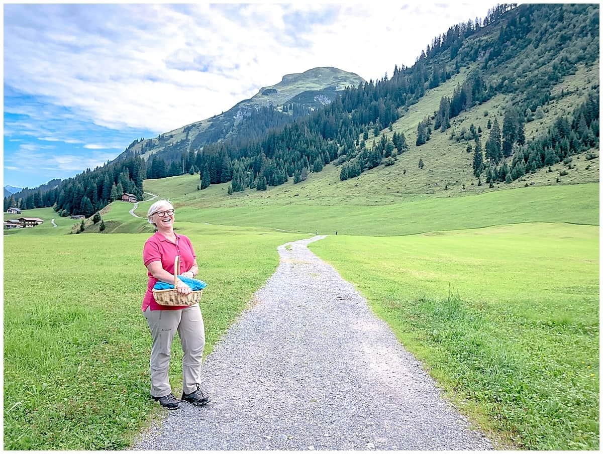 Veronika Walch leads herbal walks along a flat path in Lech Austria