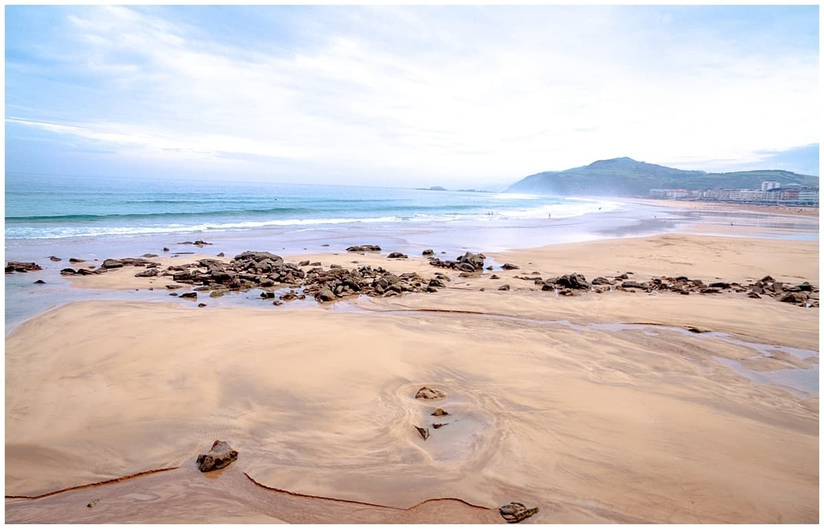 Sand shore with churning water along the coast from Donostia San Sebastian Spain