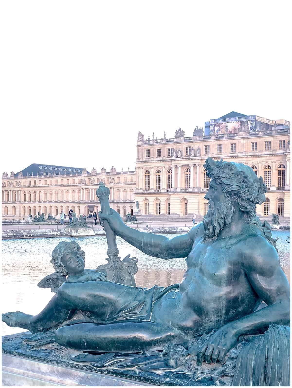 Versailles day trip from Paris - Neptune reclining in front of Palace of Versailles