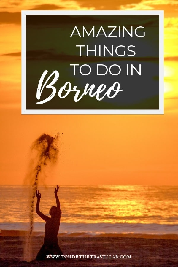 Amazing things to do in Borneo Sabah Malaysia article with child throwing sand in the air at sunset near Kota Kinabalu