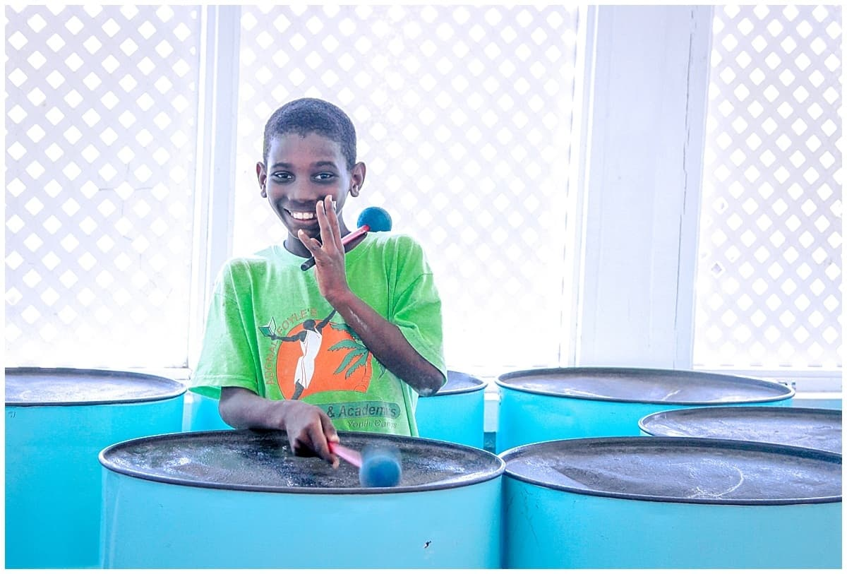 Boy plays steel band as an authentic travel experience in the best islands in the caribbean