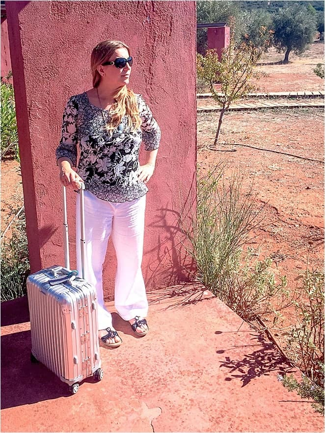 Abigail King with Rimowa suitcase