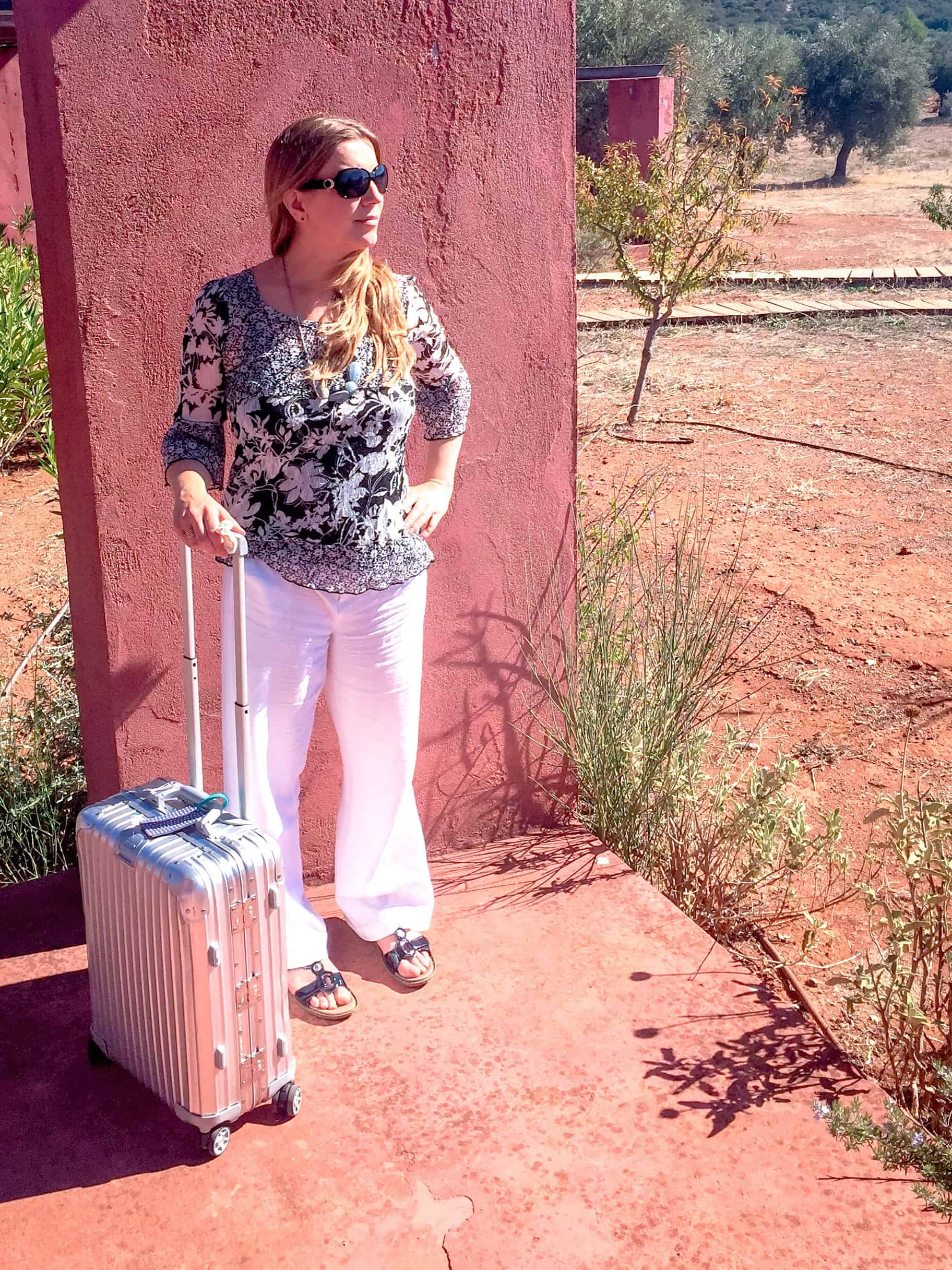 Abigail King with Rimowa suitcase for cabin luggage