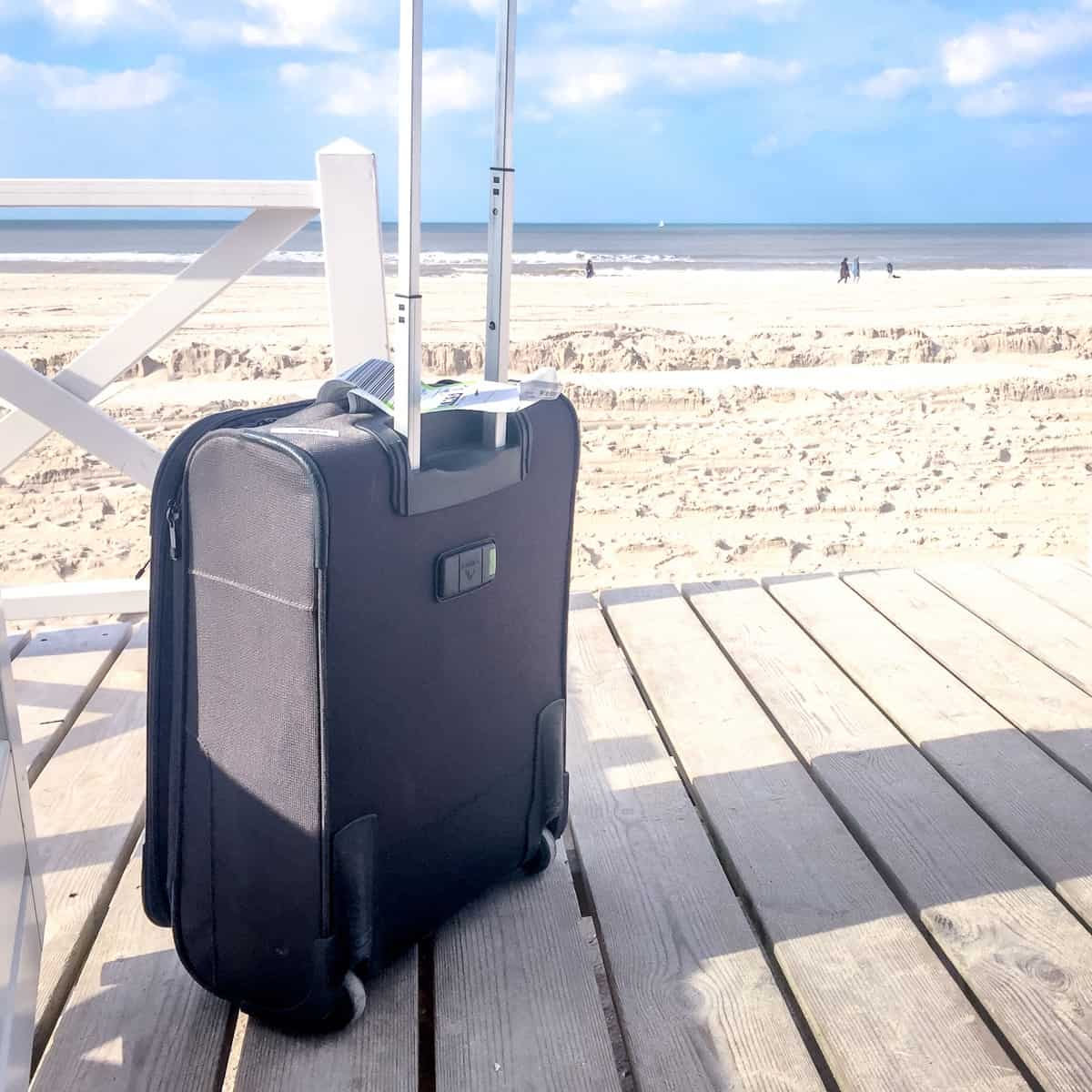 Suitcase in front of a beach