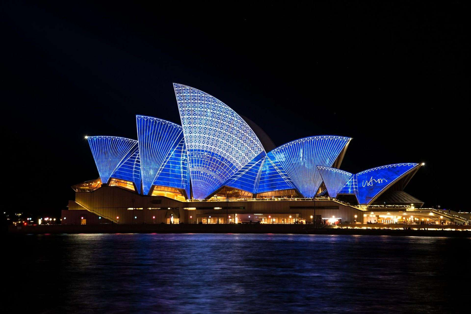 Sydney Opera House at night with blue lights