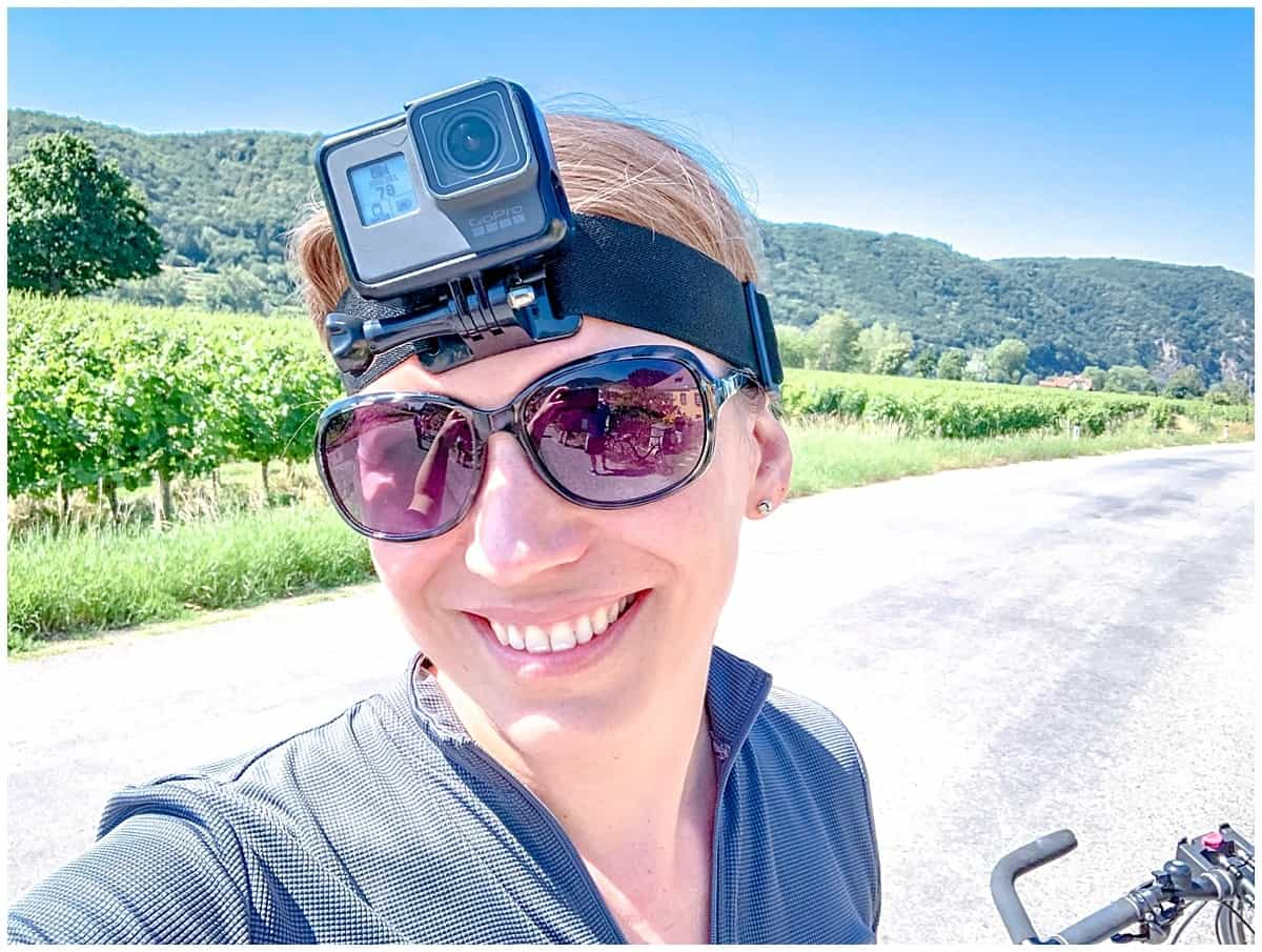 Abigail King wearing a GoPro and cycling