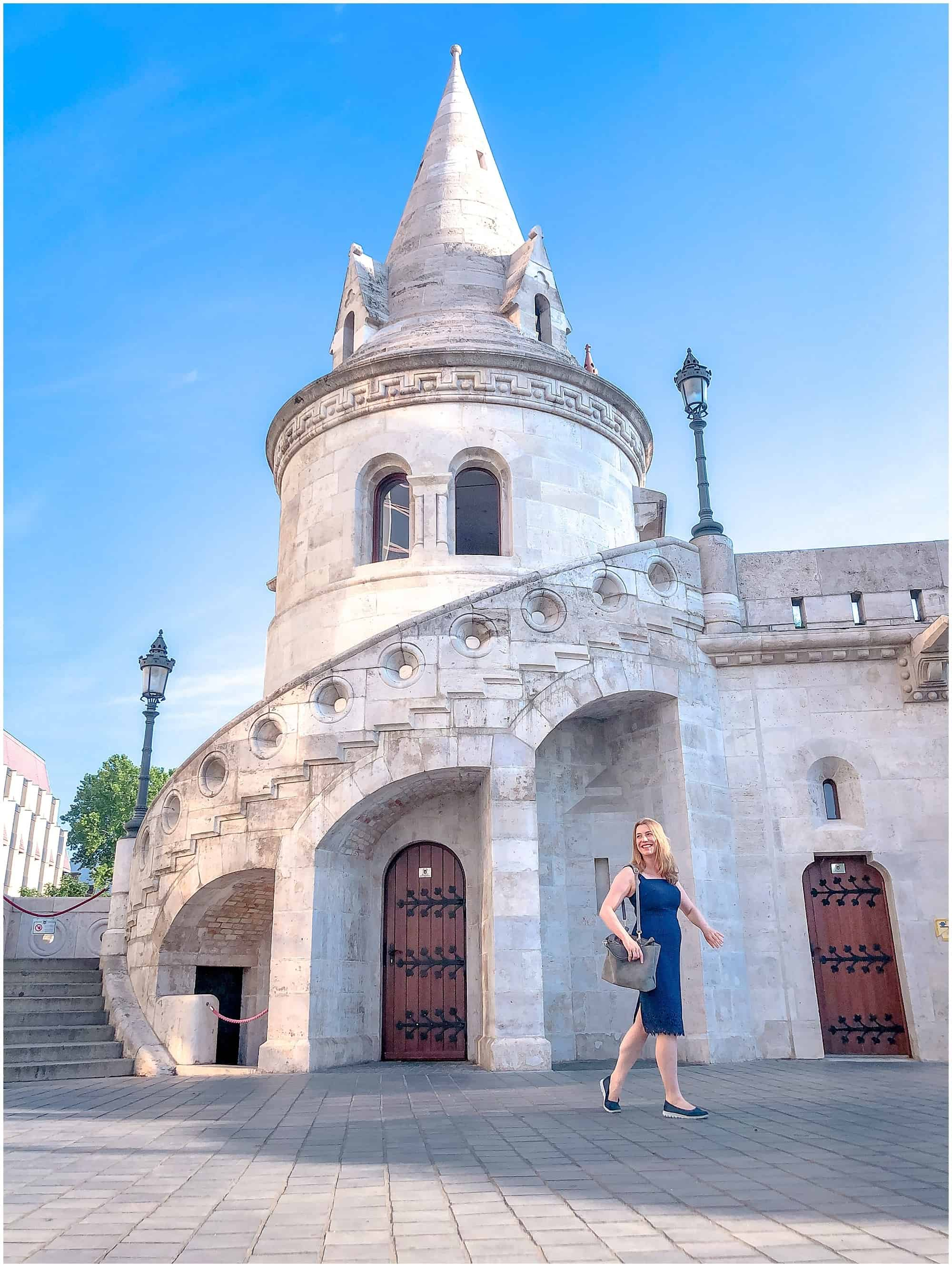 Abigail King walking past turret on Fishermen's Bastion Budapest