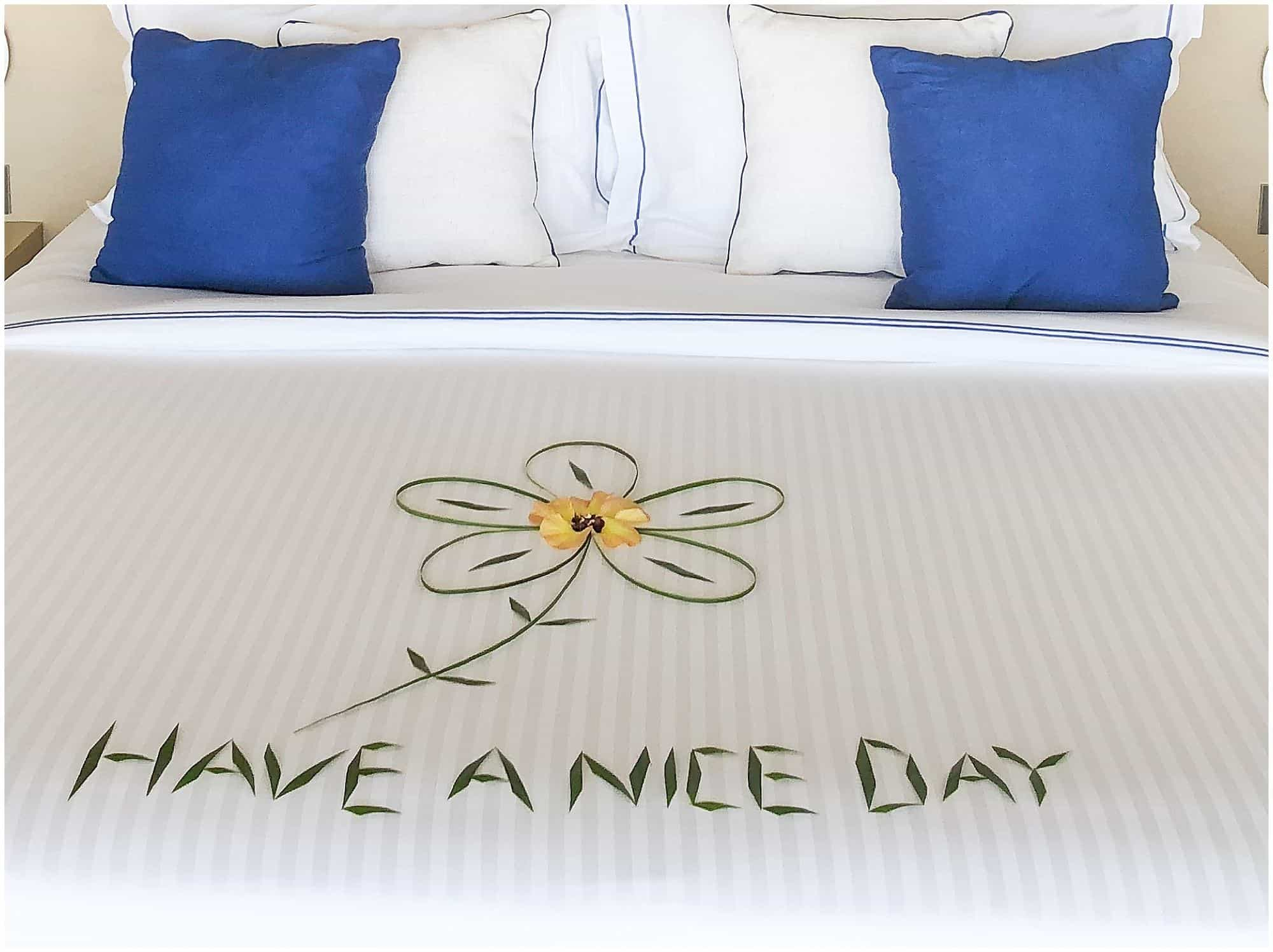 Have a nice day written on hotel bed