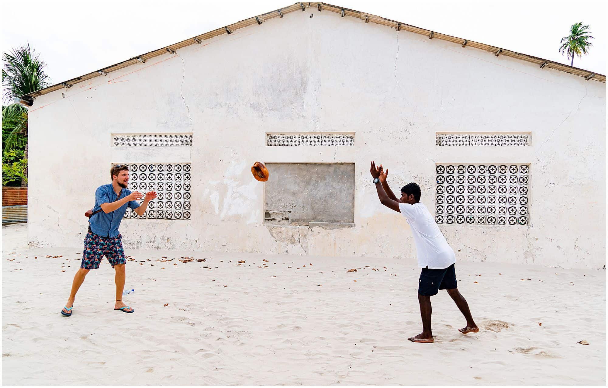 Throwing a coconut on Rinbudhoo Island in the Maldives