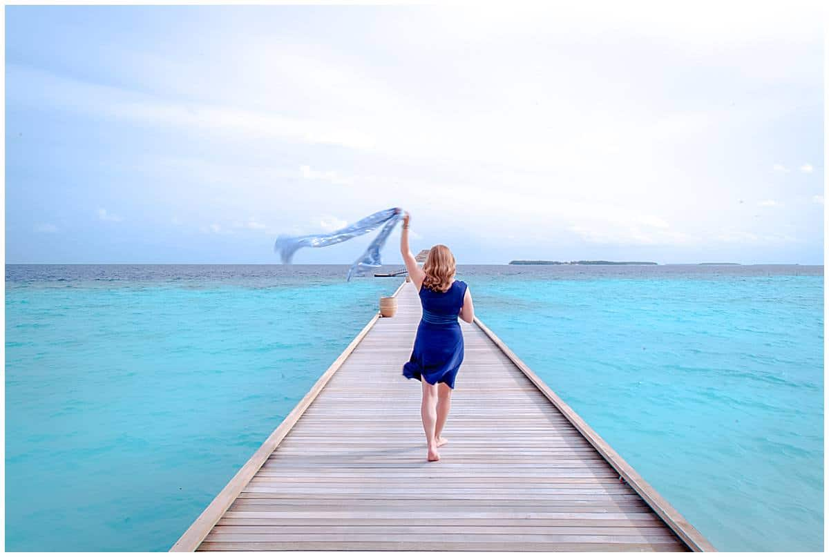 Woman on platfrom in Maldives - Abigail King-1