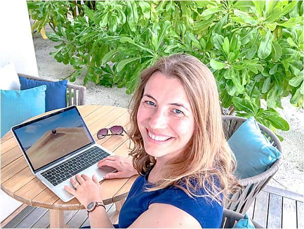 Abigail King from Inside the Travel Lab looking at the camera while working and talking about becoming a writer