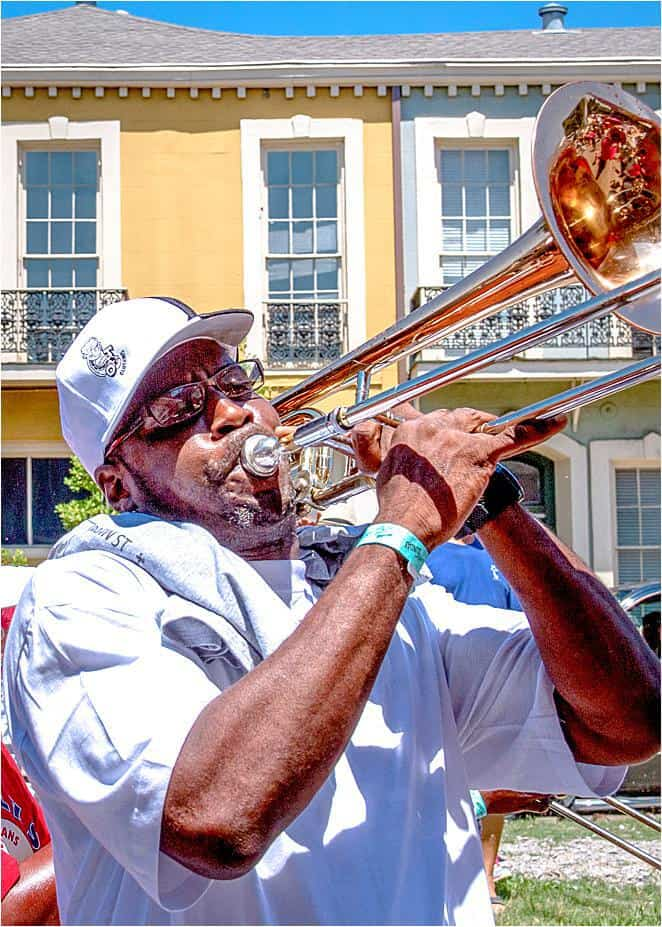 Man playing trombone as part of a New Orleans Itinerary