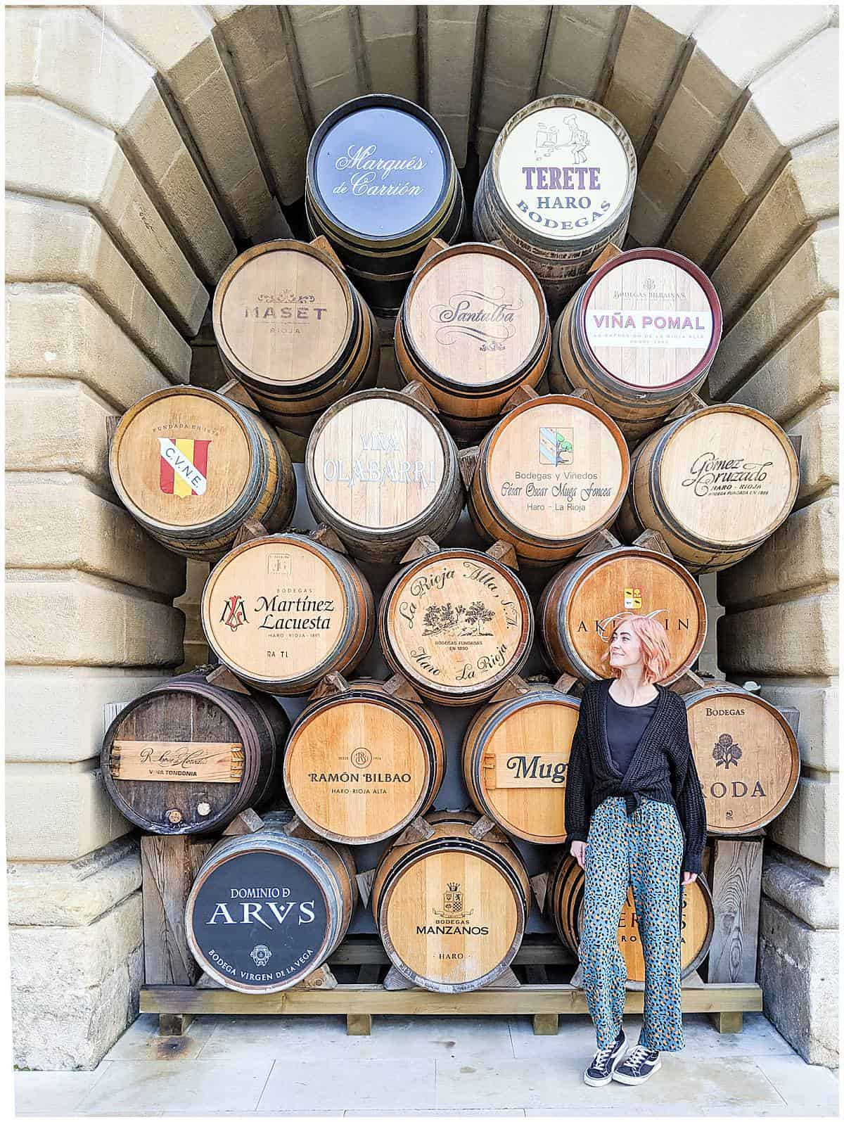 Spain - La Rioja - Haro - woman standing in front of barrels