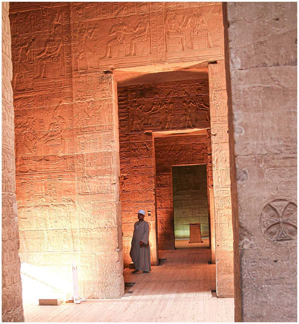 Man walks through the shadows of ancient Egypt at the Philae Temple near Aswan