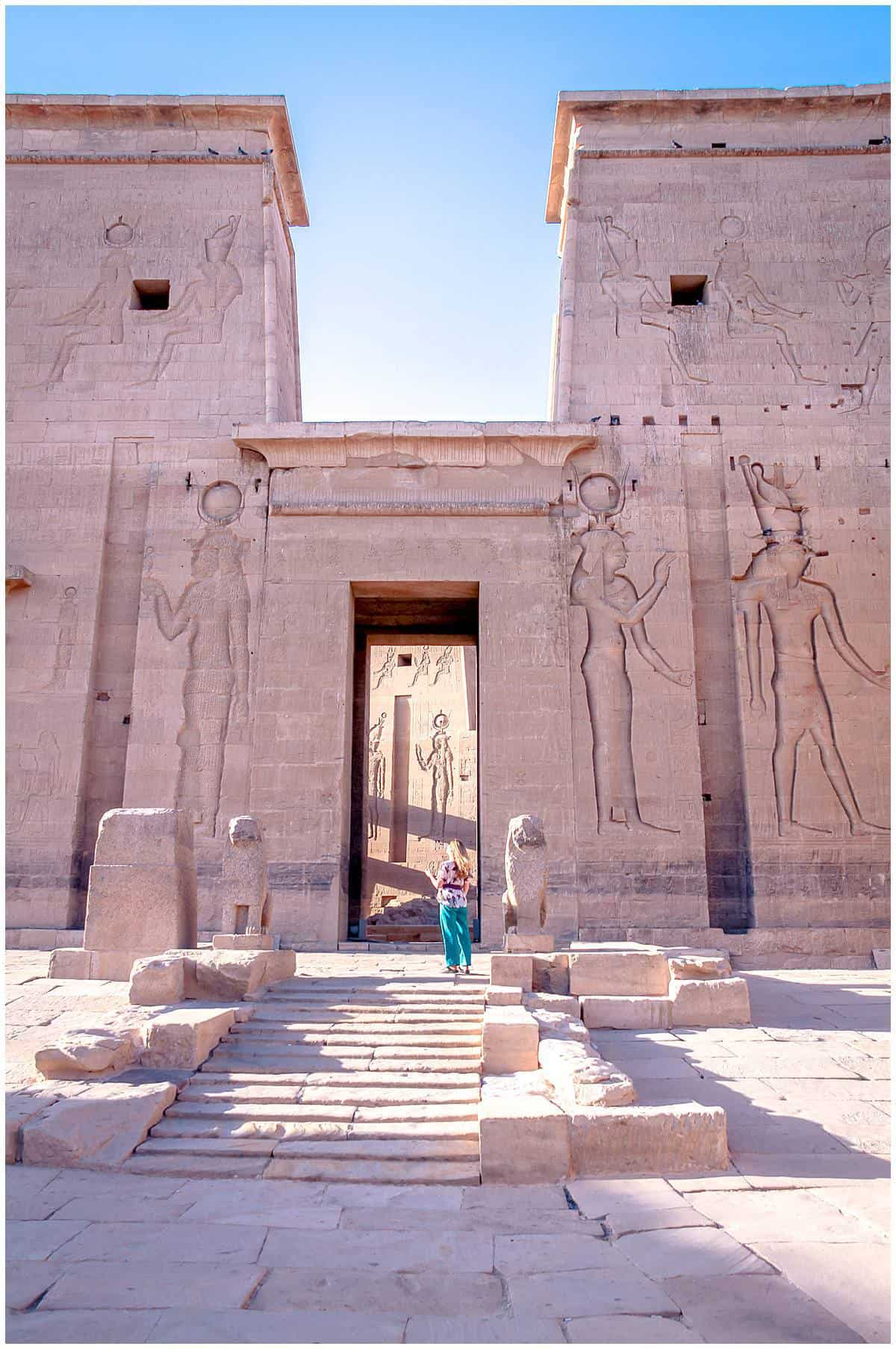 Egypt - Aswan - Philae Temple - woman standing at entrance - Abigail King travel writer