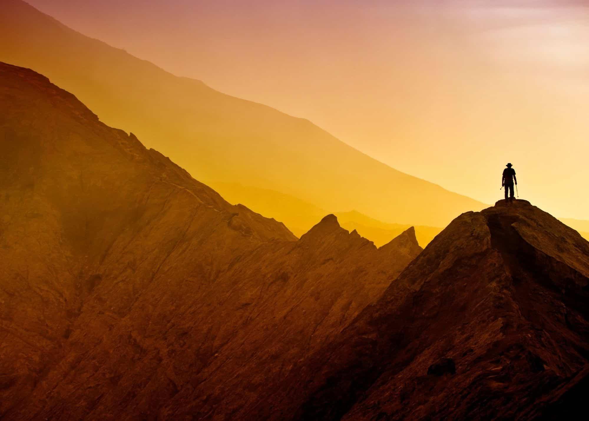 Mountain range hiking in summer orange silhouette