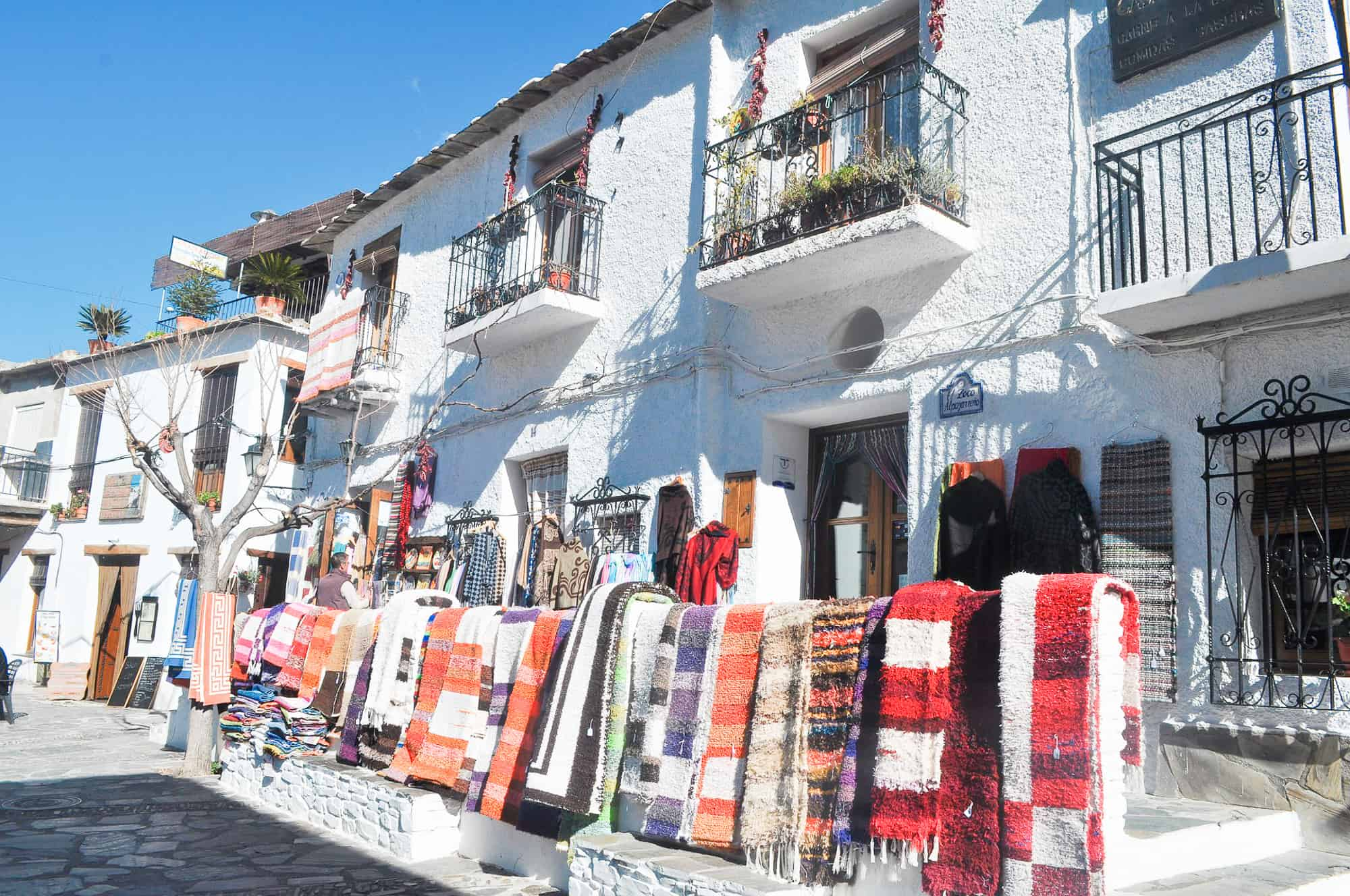 Spain - Andalucia - Alpujarras Mountains - Street view with rugs