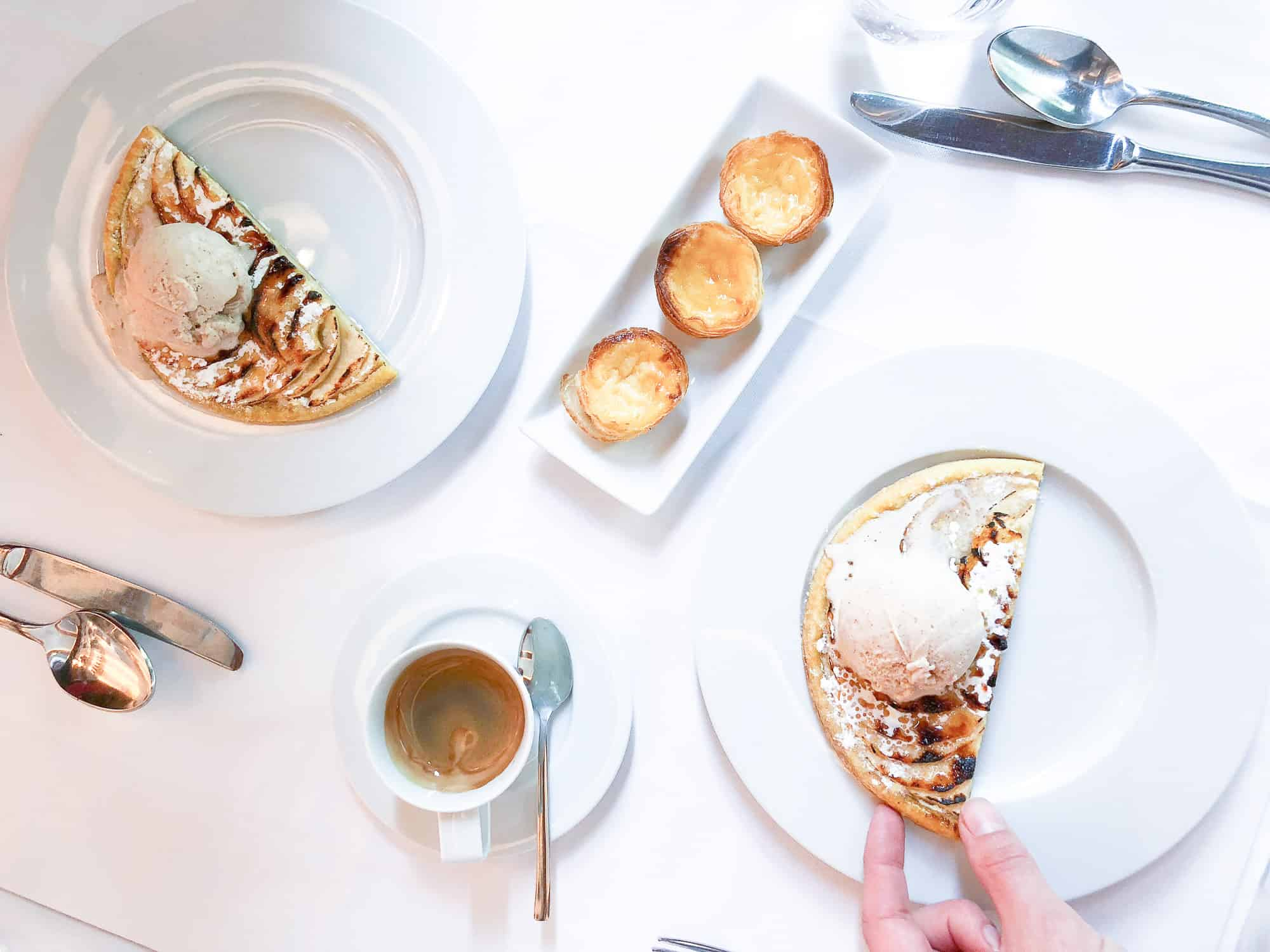 Food and drink quiz questions - woman in Borneo - round the world food questions - elegant pastel de nata platter with ice cream and pancakes