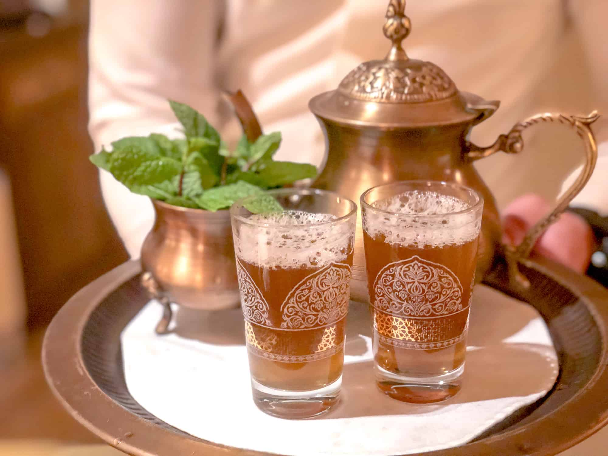 Food and drink quiz questions - woman in Borneo - round the world food questions - mint tea in the Middle East