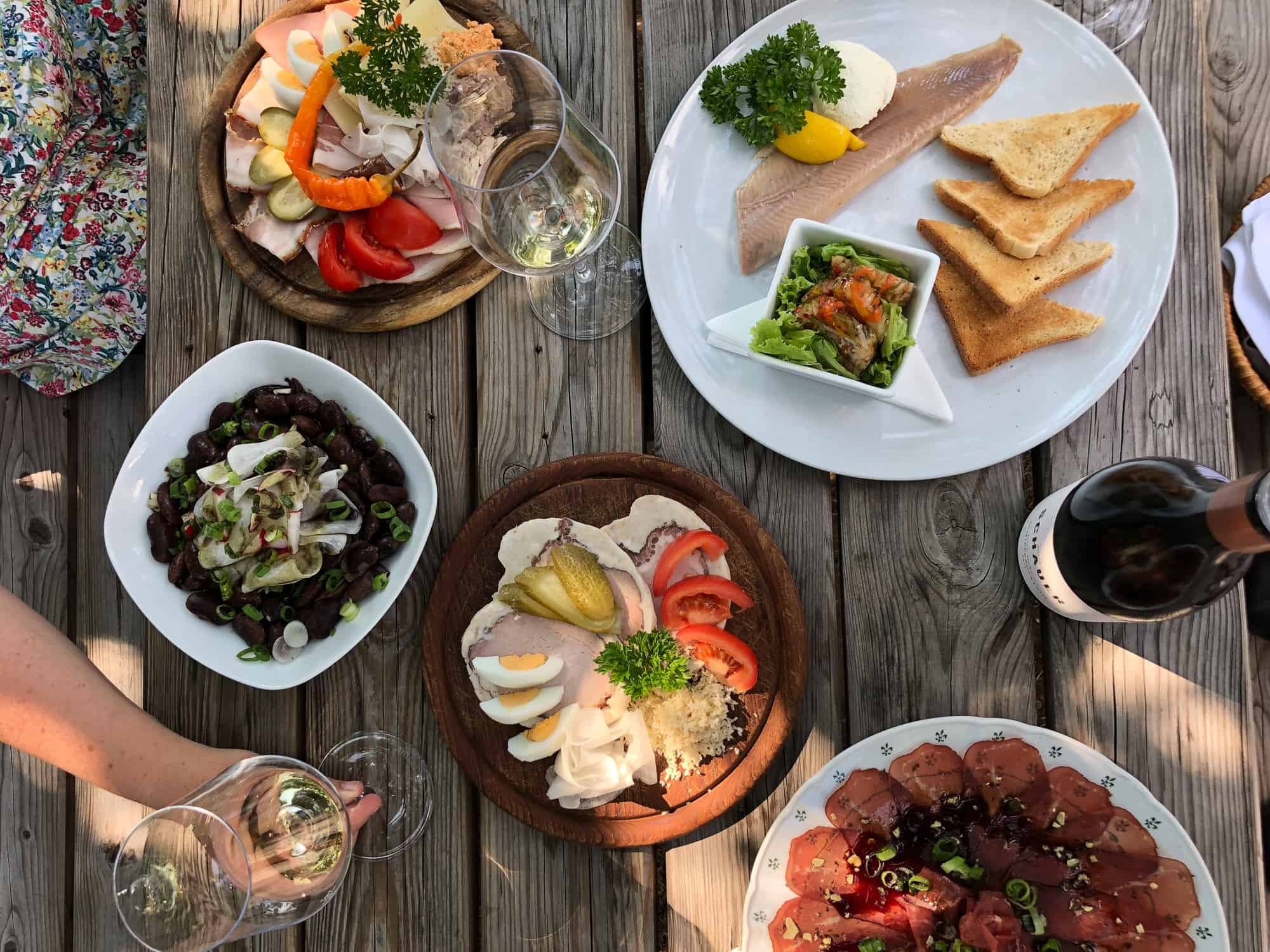 Food and drink quiz questions - woman in Borneo - round the world food questions - outdoor food platter