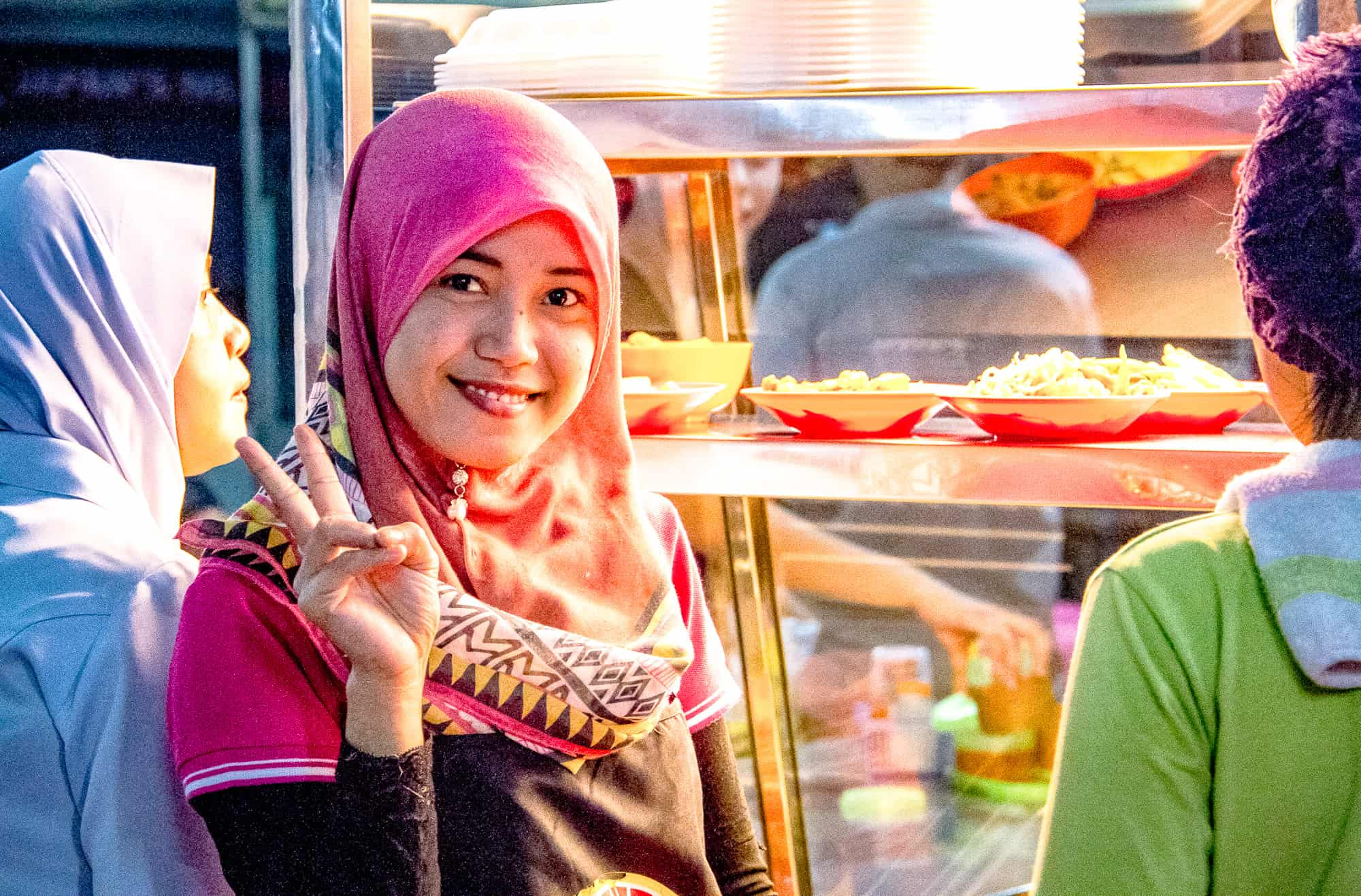 Food and drink quiz questions - woman in Borneo - round the world food questions - street food